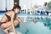 Girl near pool — Стоковое фото