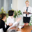 Businesswoman with presentation - Stock Photo