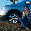 Young Blond Woman With Her Broken Car — Stock Photo #4629571