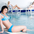 Stock Photo: Young woman near pool