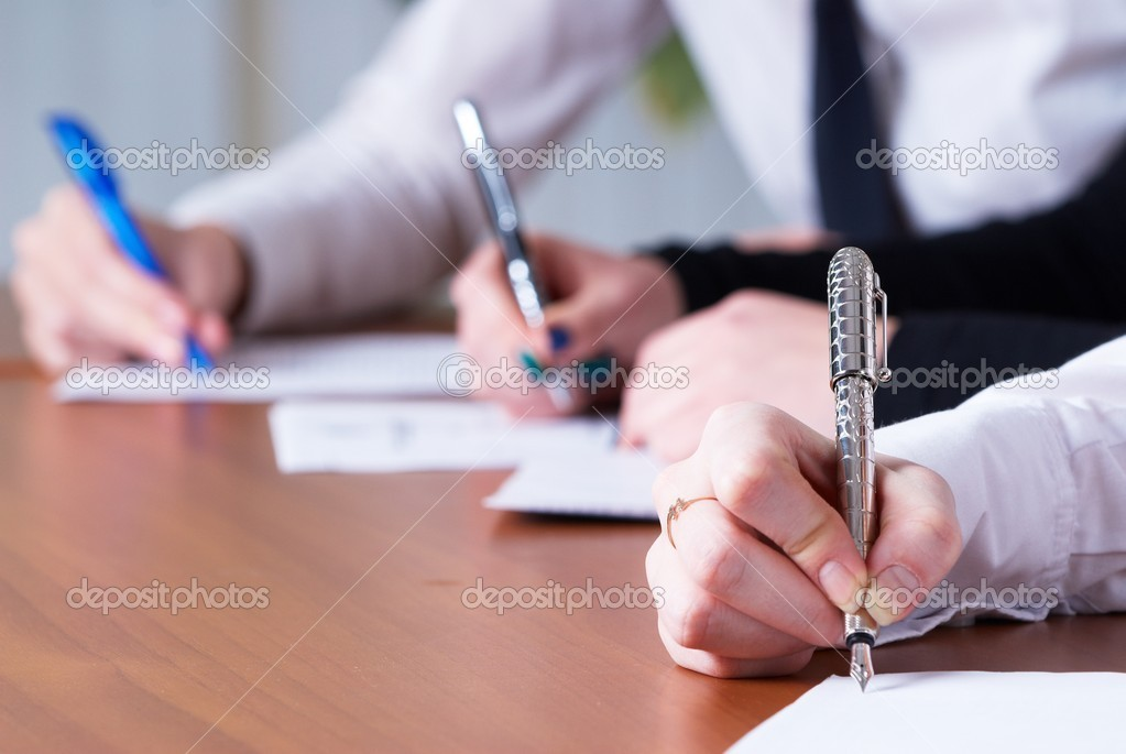 Young business woman writing document in office — Stock Photo #4745681