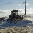Grader removing snow - Stock Photo