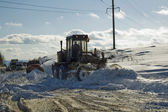 Grader removing snow — Stock Photo