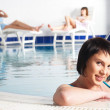 Young woman near pool — Stock Photo #4803182