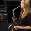 Woman with saxophone - Stock Photo