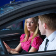 Young couple in car — Stockfoto #4859685
