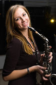 Woman with saxophone — Stock Photo