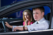 Young couple in car — Stock Photo