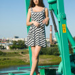 Girl on crane - Stock Photo