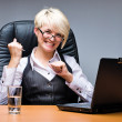 Businesswoman with laptop - Stockfoto