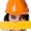 Woman in helmet with level — Stock Photo #4923431