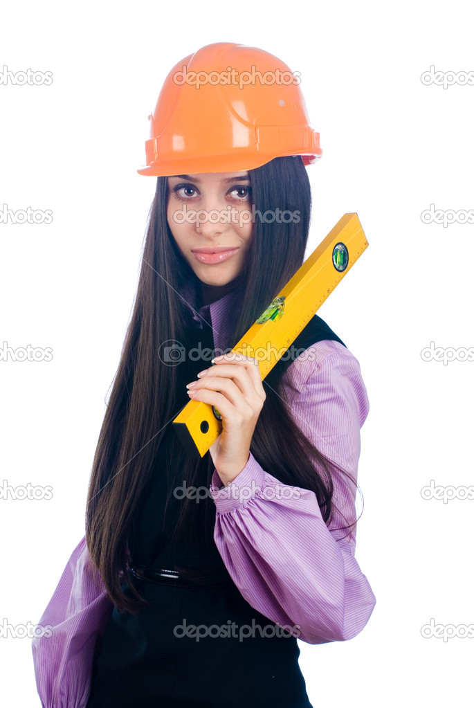 Young female worker with protection helmet and level at isolated background — Stock Photo #4952000