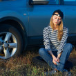 Young Blond Woman With Her Broken Car — Stock Photo #4978416