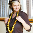 Woman with amber beads — Stock Photo