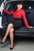 Woman in luggage compartment — Stock Photo