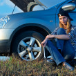 Young Blond Woman With Her Broken Car — Stock Photo #5176307