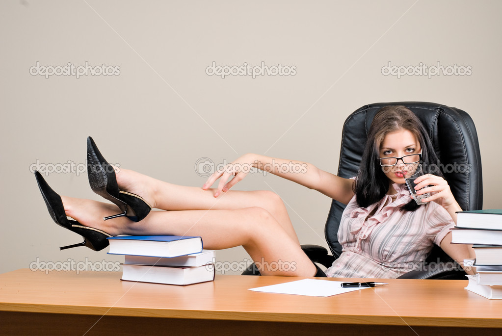 Young pretty woman - boss sitting behind table — Stock Photo #5175076