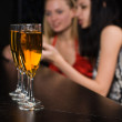 Young women in a bar — Stock Photo