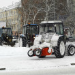 Snowplow in the city street — Stock Photo