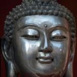 Buddha statue in silver — Stock Photo
