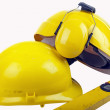 Hard hats and spirit level — Stock Photo