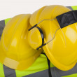 Hard hats and hi-vis jacket — Stock Photo