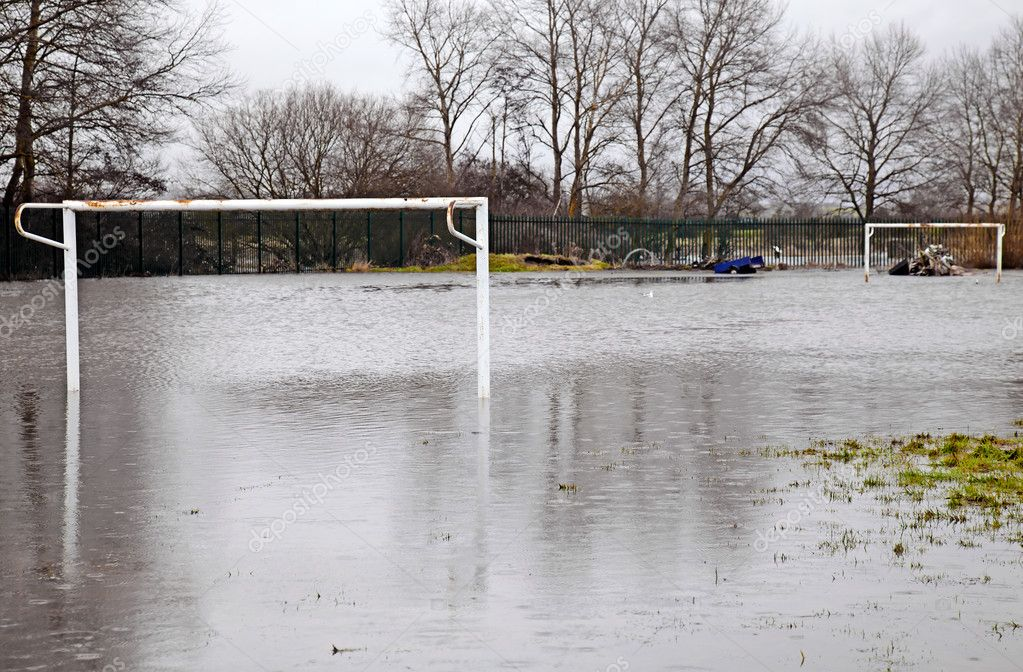 Flooded football pitch due to high rainfall bursting a river bank — Stock Photo #4844379