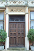 Bank Sign above door — Stockfoto