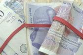 Bundles of twenty pound notes — Stock Photo