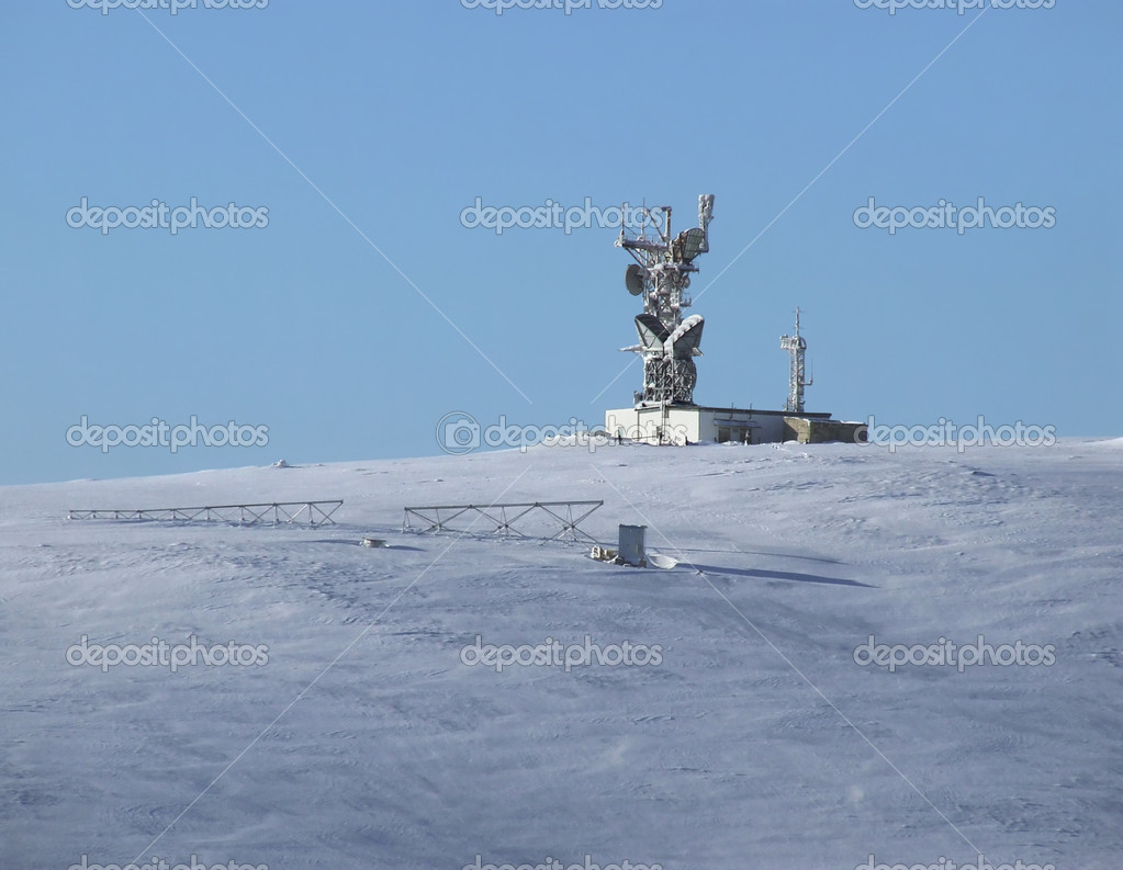 Weather station stands on the snowy plain  Stock Photo #4211481