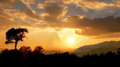 Sunset in shady hills — Stock Photo