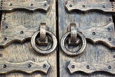 Decorative door with forged handles — Stock Photo