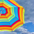 Colorful beach umbrella against the sky — Foto de Stock