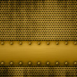 Gold metal plate on a metal grill — Stock Photo #5339945