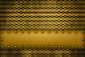 Gold metal plate on a metal grill — Stock Photo
