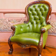 Green leather armchair — Stock Photo #4421295