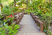 Wood bridge in the garden — Stock Photo