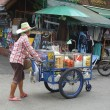 Stock Photo: Thai fruit vendor with cart