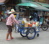 Thai fruit vendor with cart — Stock Photo