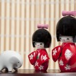 Two small Japanese dolls and small elephant — Stock Photo #3941627