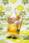 Yellow Angel on the flower paper background — Stock Photo