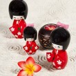 Trhee Japanese dolls on paper background — Stock Photo