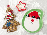 Santa plate and Christmas tree and Star cup on leaf paper background — Stock Photo