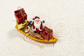 Lonely Santa on the boat with his gifts — Stock Photo