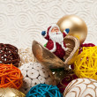 Santa surprises from the seed around Christmas ball decorations — Stock Photo #4454643