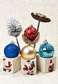Four Christmas balls with nelumbo lotus and pine cone — Stock Photo