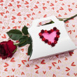 Valentine paper bag with heart symbol and rose — Stock Photo