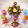 Colorful heart candle with bucket of rose — Stock Photo