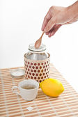 Putting honey in the cup of tea — Stock Photo