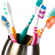 Toothbrushes in metal cup — Stock Photo